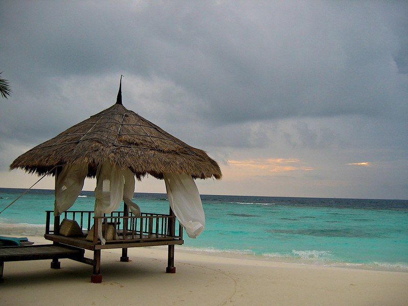 Every villa has a small covered beach bed along the beach.