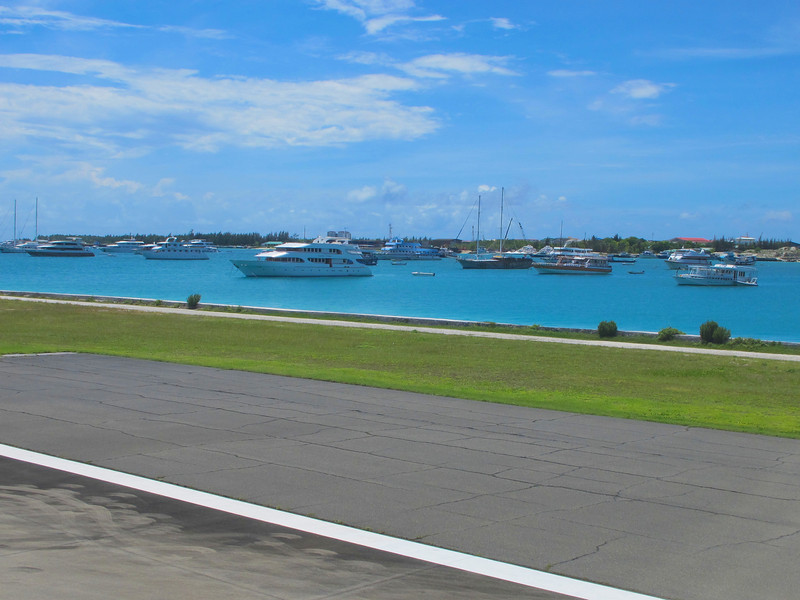 As we land at Male International, you can see many of the high dollar luxury yachts moored right off the main runway.
