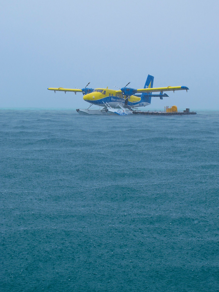 Since you're arriving by sea plane, you land, well, on the sea.  A small boat from the resort will come and pick you up from the platform about a 1/4 mile out in the ocean.  You can wait in the plane if it's raining.