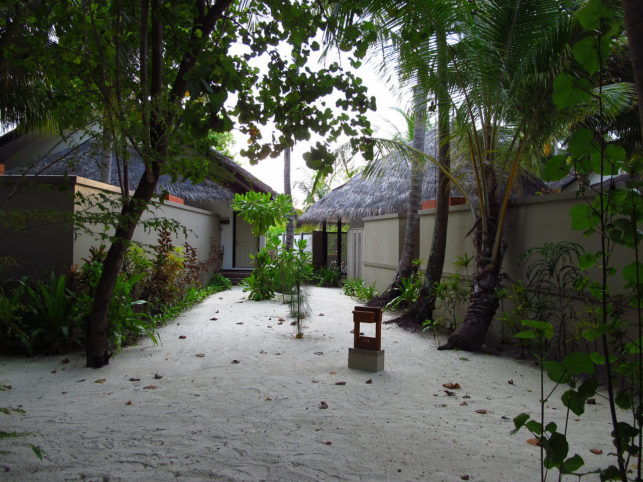"While we had intended to stay only in a ""beachfront villa"" during our stay, we had an opportunity to also stay in a 2BR and 1BR in-ocean villa.  This is the ""beachfront villa"".  Each villa shares an entrance path with another villa."