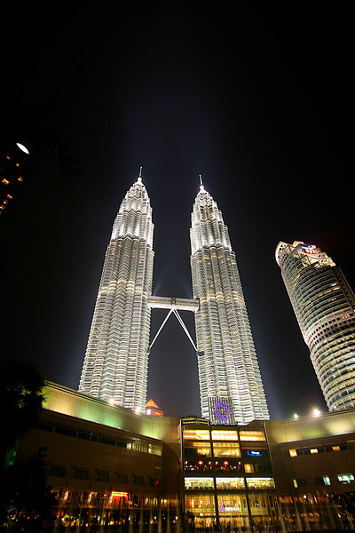 The Petronas Towers feature a diamond-faceted facade consisting of 83,500 square metres (899,000 sq ft) of stainless steel extrusions. In addition, a 33,000-panel curtain wall cladding system resides within the towers. While the stainless steel element of the towers entices the illustrious sun, highlighting the magnificent towers, they are composed of 55,000 square metres (590,000 sq ft) of 20.38-millimetre (0.802 in) laminated glass to reduce heat by reflecting harmful UV rays.