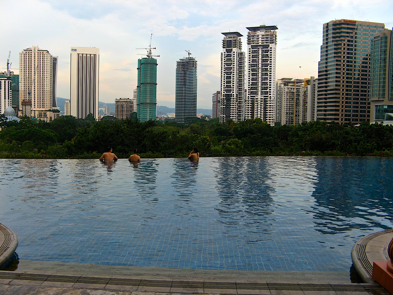 ..and features an infinity edge pool a few floors off the ground with great views of the city.