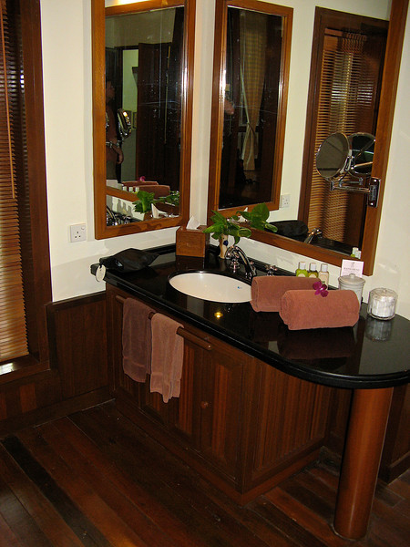 There are double vanities, one on each side in the bath area.  Double sets of closets are also provided.