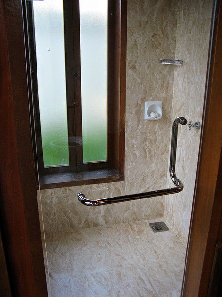 A nice marble shower is very spacious.