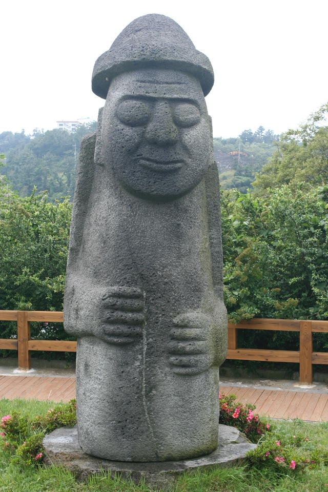 """This is Dolharubang, which means """"stone grandfather"""".  These statutes are everywhere on the island and are made out of the indigienous lava rock"""