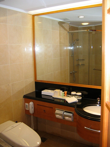 The bathroom is nicely appointed with marble floor and shower
