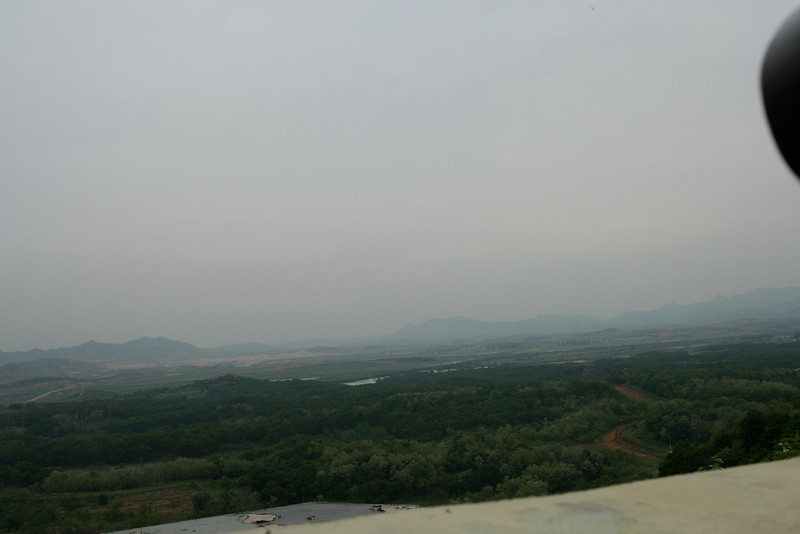 Here you can see into North Korea, which is less than 1 mile away.  The road is the single way in and out of North Korea.  NK is just beyond the river towards the middle of the picture.