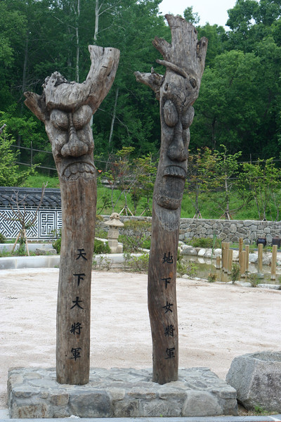 """These are Changseung's or """"totem poles"""", which are traditionally seen in various forms throughout South Korea and are used as """"guardians of the villages""""."""