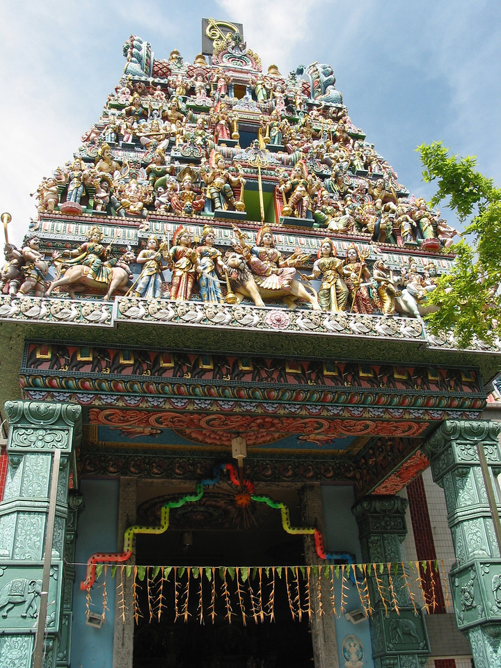 Flanking the gopuram are a sculpture of Murugan on the right and Krishna on the left. The sculptures are all of plaster, which allows for fine detailing. They are painted in a variety of bright colours, which adds to the visually spectacular quality of the gopuram.