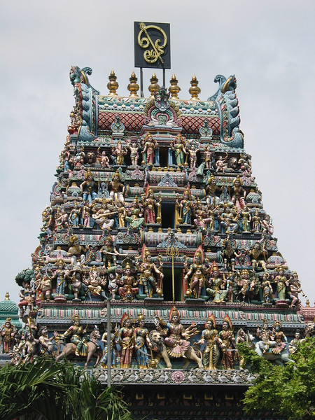 The most outstanding feature of the temple is its impressive gopuram (entrance tower). It is richly embellished with six tiers of sculptures of Hindu deities, other figures and ornamental decorations.  The scale of each tier and its sculptures is slightly smaller than that of the tier immediately below it. This helps to create the illusion of height, and adds to the symbolic importance of the building.