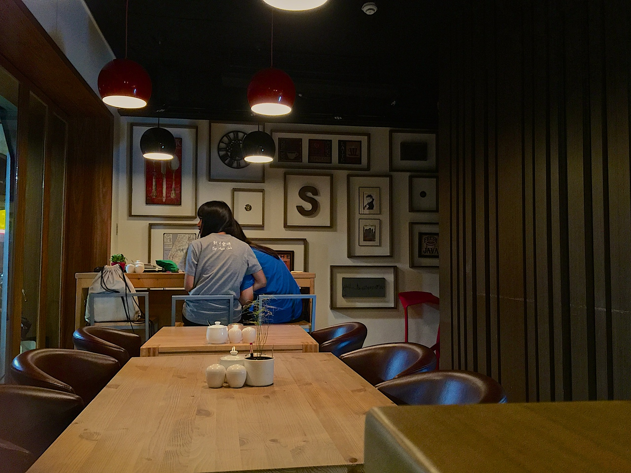 Once inside the small space, you can have an espresso, that's really great or walk behind the wood panel on the right, where you think the building stops.  Look high on the wall for a very small button, push and wait....