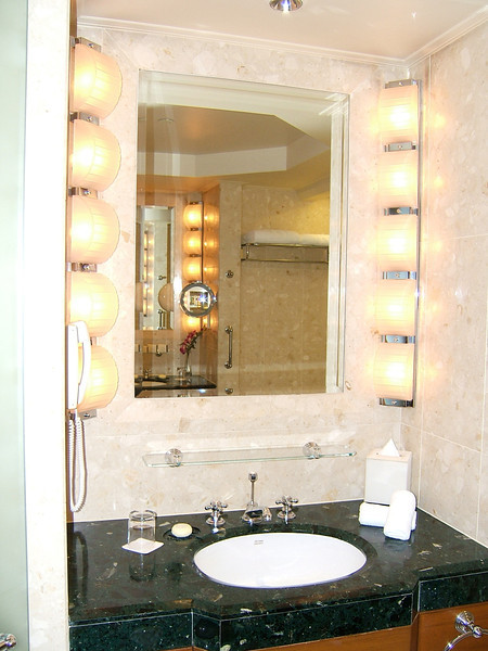 Bathrooms are large, featuring well lit mirrors and marble throughout.
