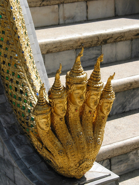 "Gold adorns just about all aspects of the palace area including these ""toes"" that run down a staircase."