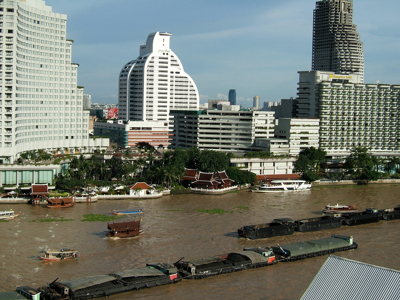 Directly across from the Peninsula is the Mandarin Oriental on the left and the Shangri-La on the right.  Barges are a constant sight on the river.