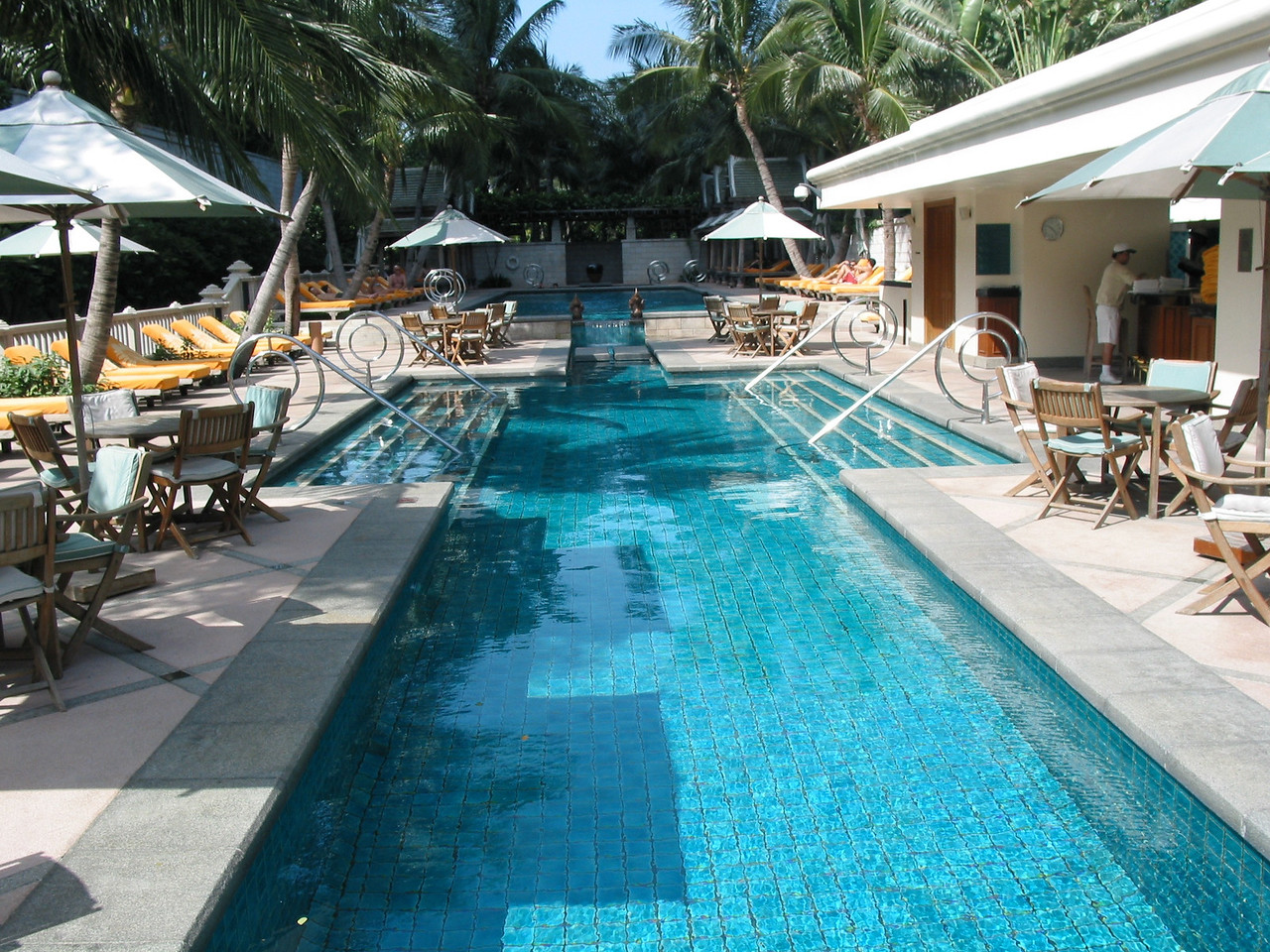 The pool area is large and has an infinity edge at the opposite end facing the Chao Praya.