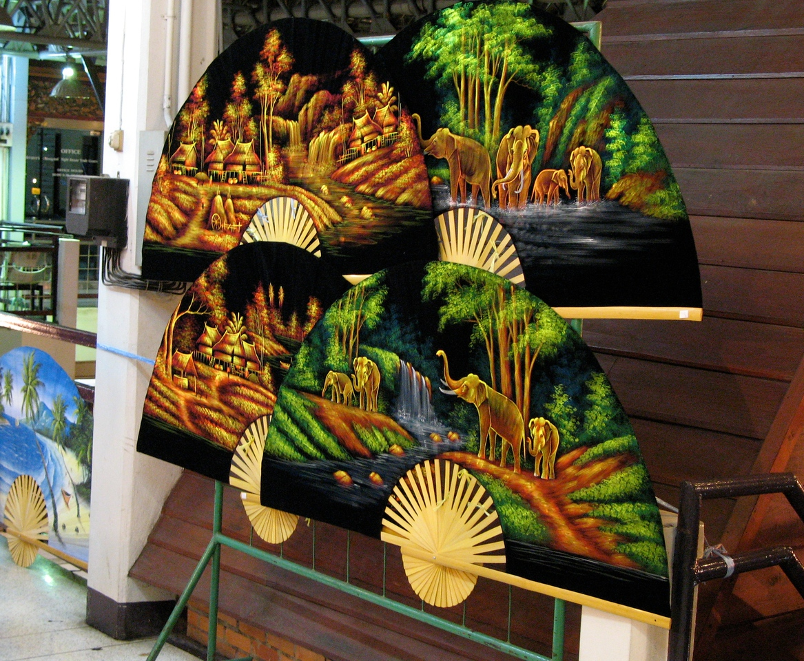 Fan and umbrella painting is a talent in this area of Thailand.