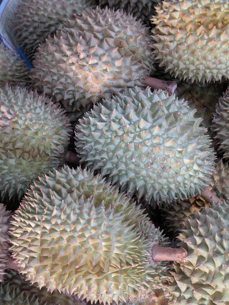 These are Durian fruit.  They smell like an open sewer line when you carve them.  Everyone says it's an acquired taste.