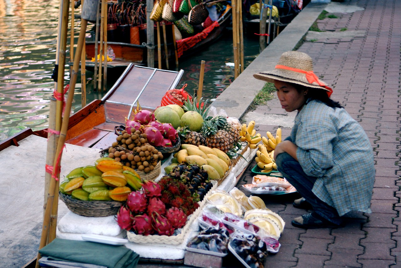 When we get off of our boat, we walk around the outside of the floating market.  Eventually we'll board a paddle boat, that will take us through the market itself.