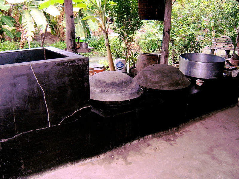 Coconuts are boiled in these large vats and then the solids are strained out and you're left with the syrup.