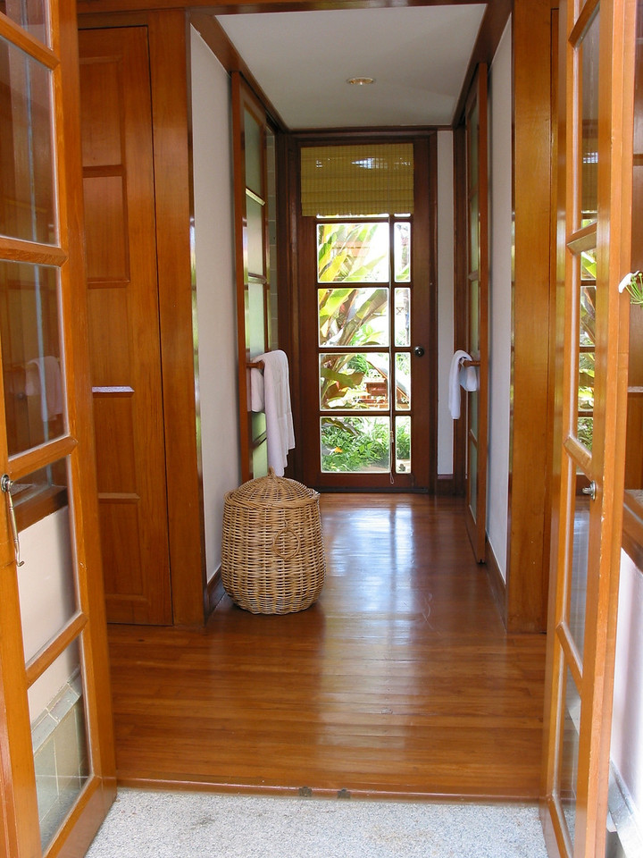 A separate hallway leads to the bathroom and outdoor tub area.