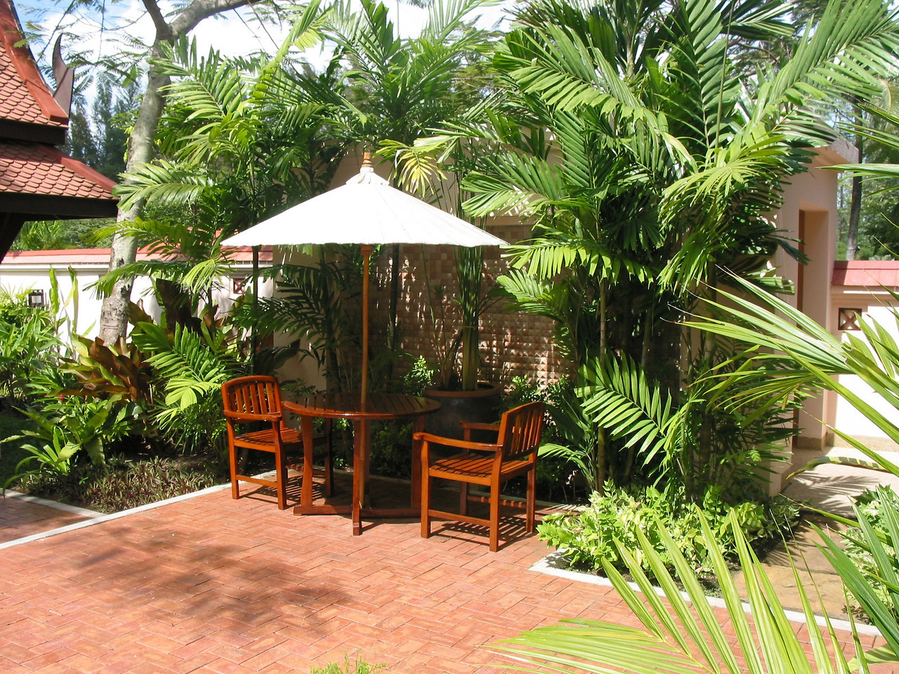 Want to dine outside in your villa, no problem.  There's a nice umbrella and table.