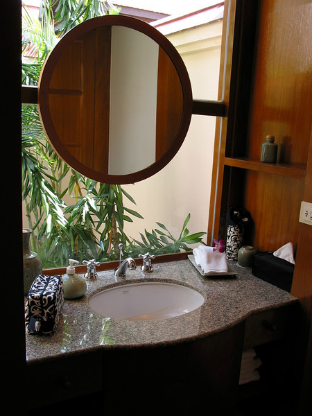 The bathroom sink overlooks the outdoor tub.