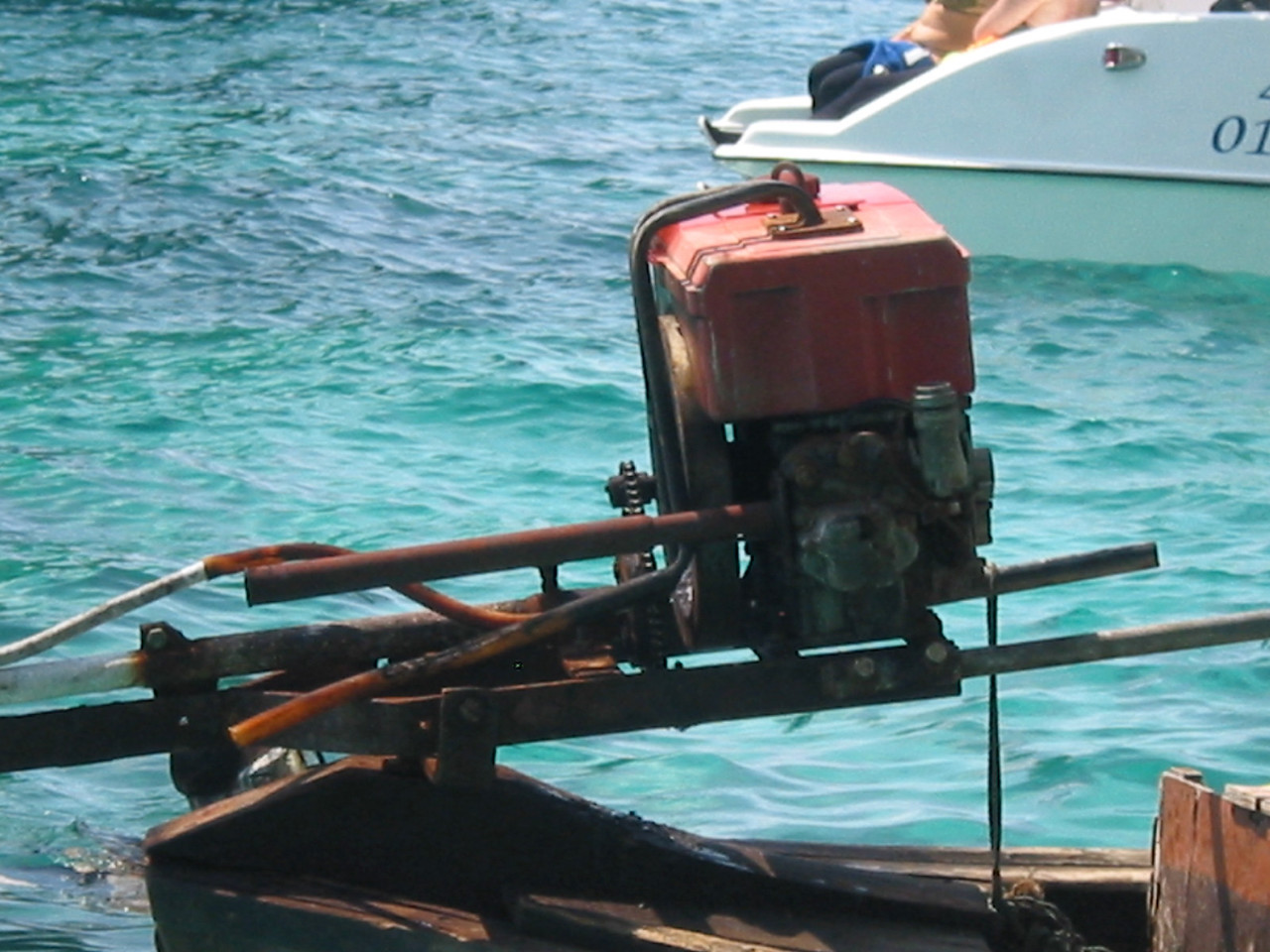 The long boats are powered by old car and truck GM V8 engines.