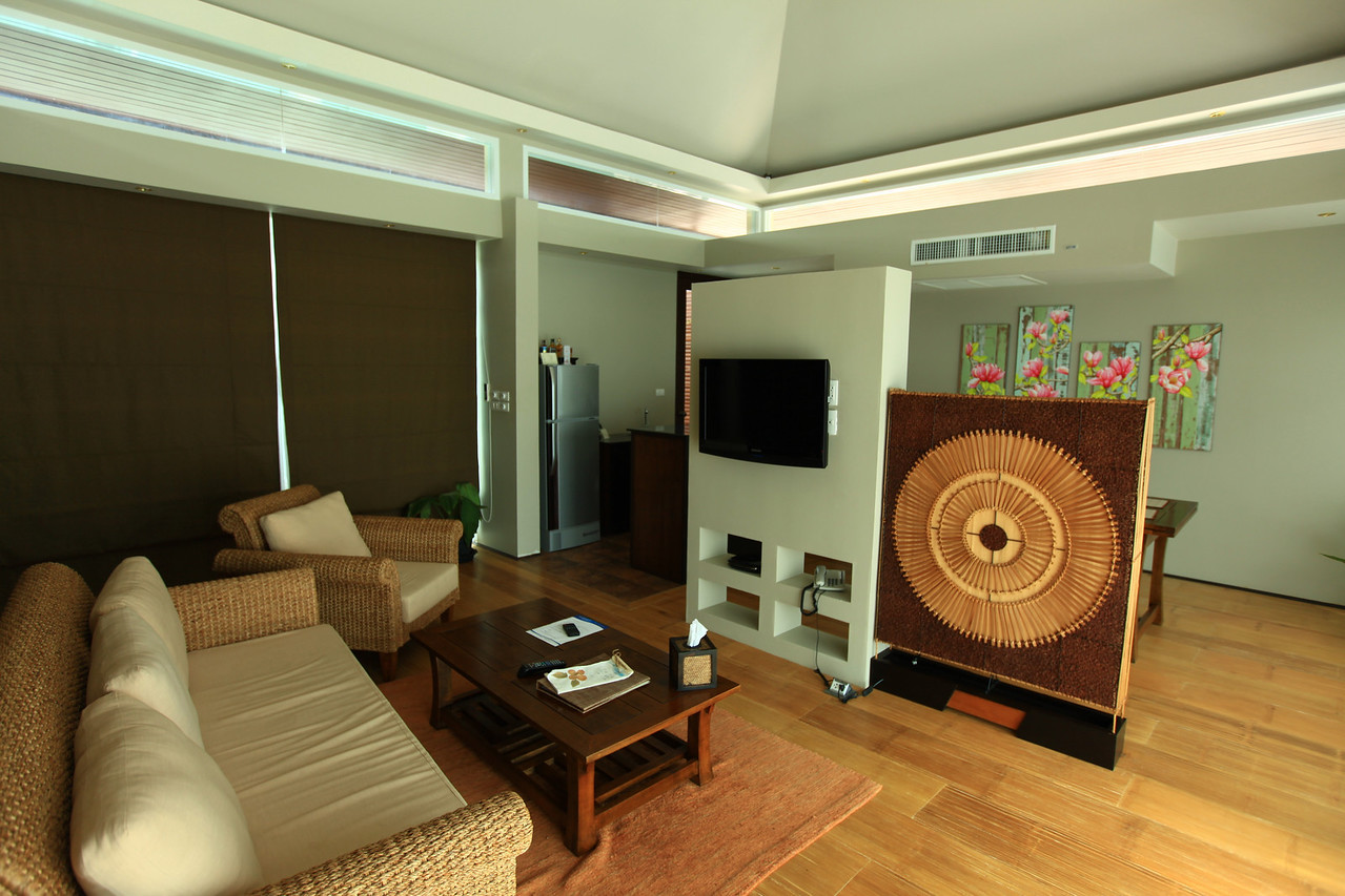 In the other building is the living room, complete with TV, refirgerator, kitchen and...