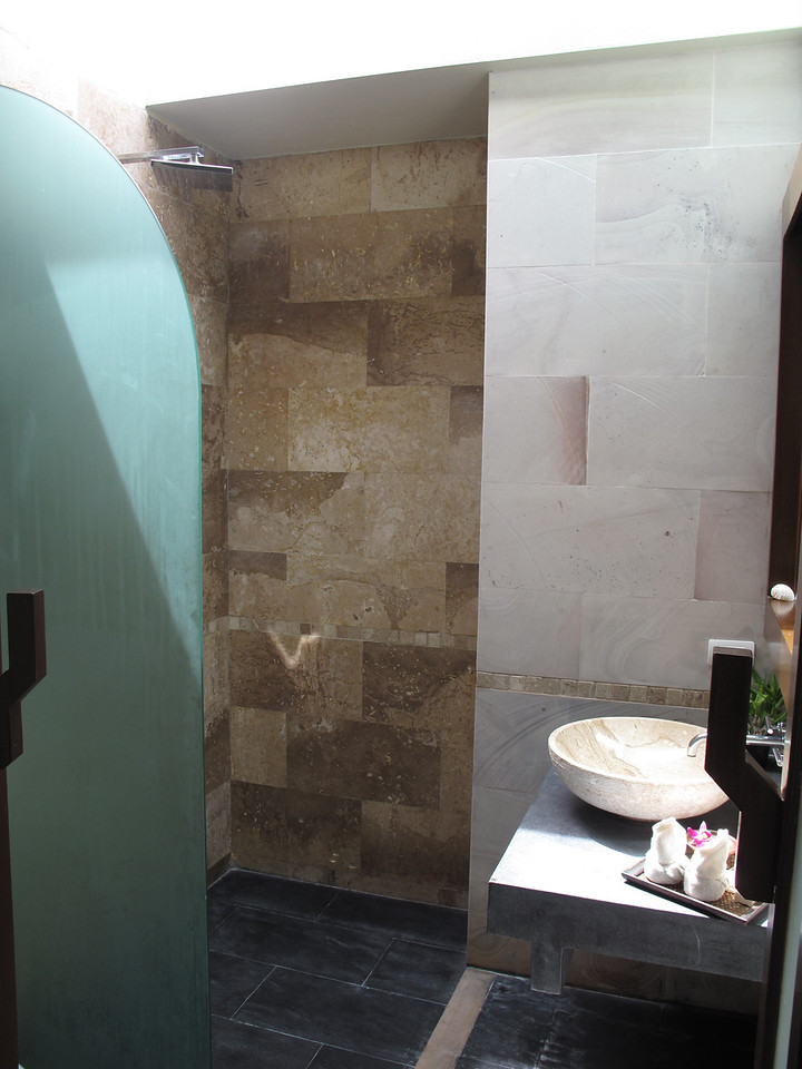 Each of the two bedrooms has an outdoor bathroom and shower area, which is typical in Thailand resorts.