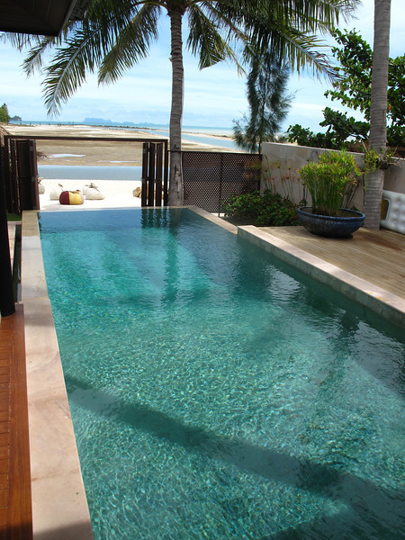 You can close the doors at the end of the pool for privacy or open them up to enjoy the beach scenery beyond.