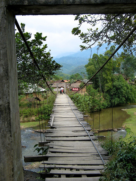 On our way to Lai Chau, we stop at a small village.  To get there you need to cross this not so stable suspension bridge and dodge the oncoming motorbikes.