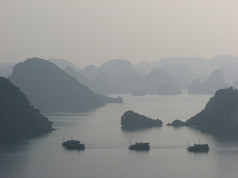 It doesn't take long for the haze to build into Ha Long bay , so grab pictures while you can.