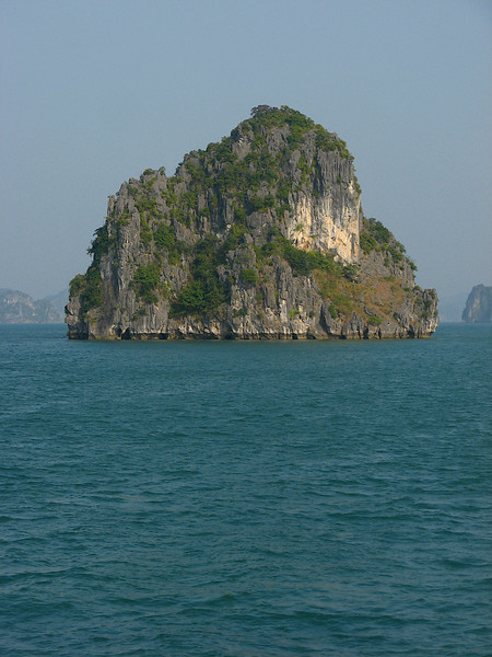 According to local legend, when Vietnamese had just started to develop into a country, they had to fight against invaders. To assist Vietnamese in defending their country, the gods sent a family of dragons as protectors. This family of dragons began spitting out jewels and jade. These jewels turned into the islands and islets dotting the bay, linking together to form a great wall against the invaders. Under magics, numerous rock mountains abruptly appeared on the sea, ahead of invaders' ships; the forward ships struck the rocks and each other. After winning the battle, the dragons were interested in peaceful sightseeing of the Earth, and then decided to live in this bay. The place where the mother dragon descended was named Hạ Long, the place where the dragon's children attended upon their mother was called Bái Tử Long island and the place where the dragon's children wriggled their tails violently was called Bạch Long Vỹ island present day Trà Cổ peninsula, Mong Cai.