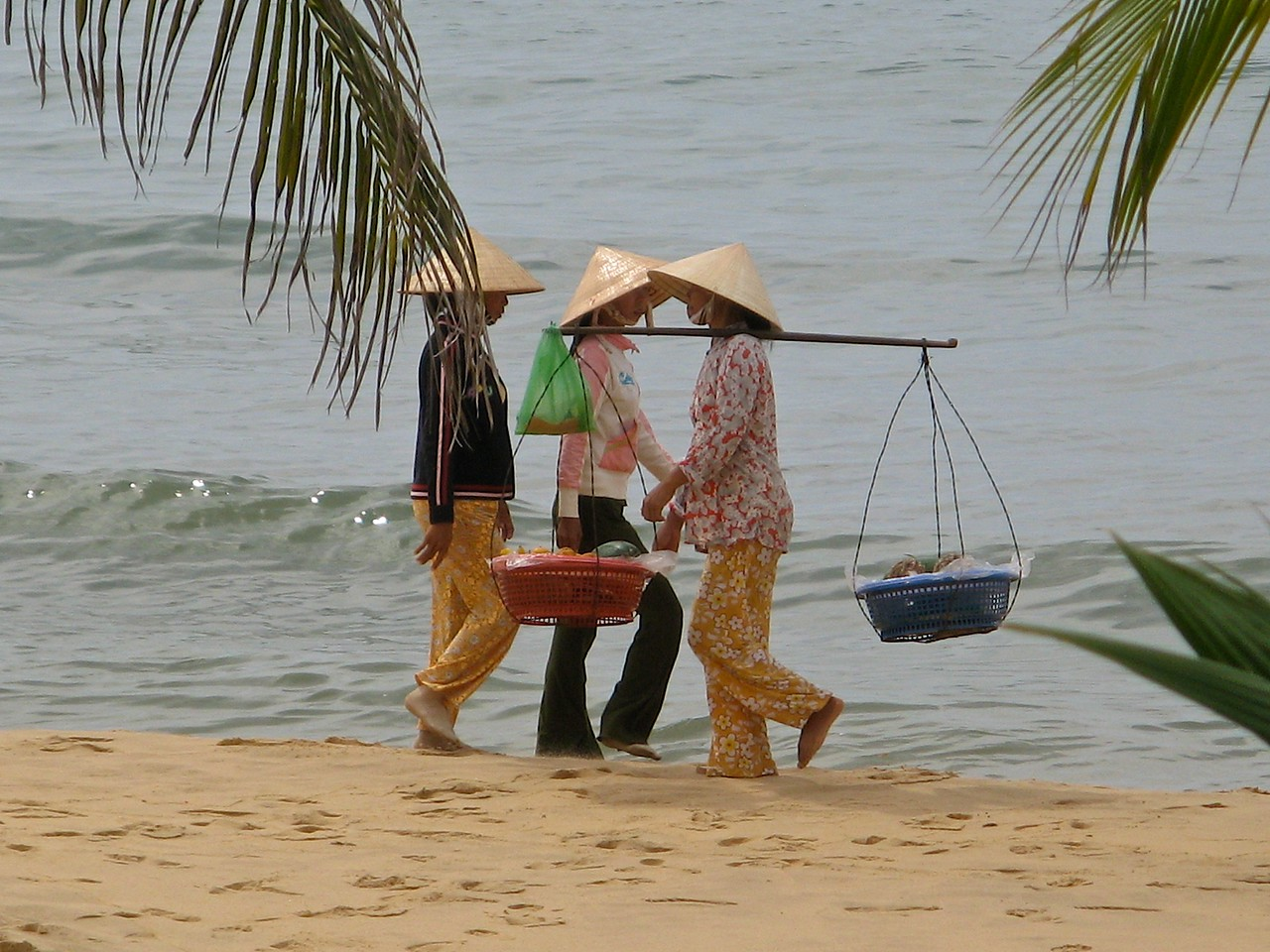 Many locals walk up and down the beach during the hot days.