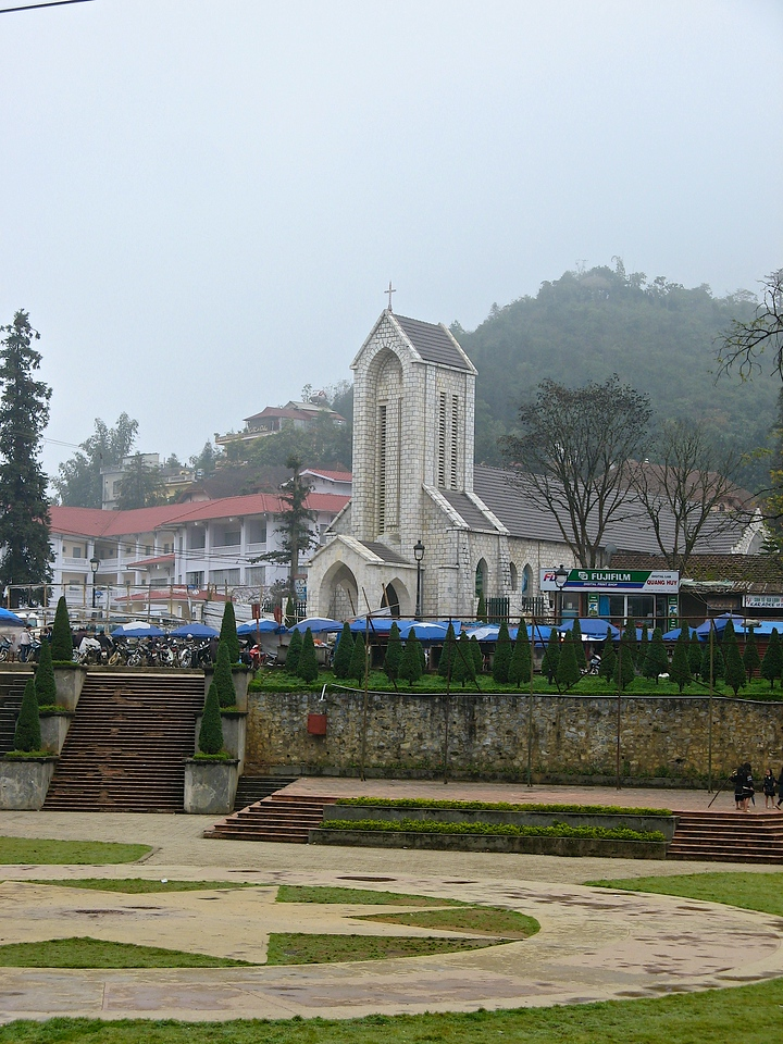 The Stone Church in Sapa was building in the early 20th century.  The building is built in the shape of a cross when seen from overhead.  On Saturday's there is a large community gathering in front of the church.