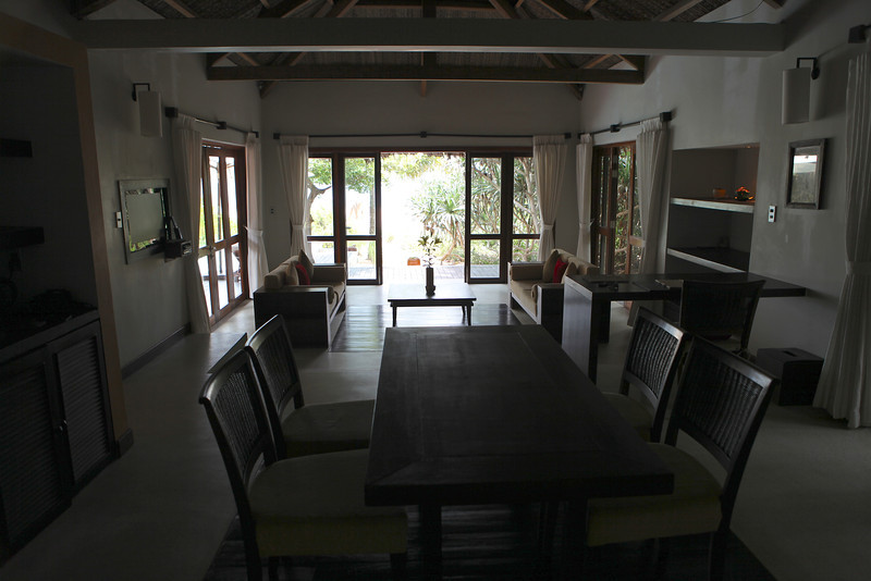 Looking from the back of the dining area, you can view the plunge pool, beach and ocean.