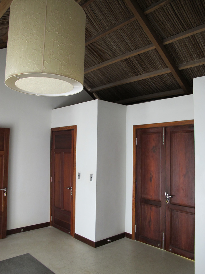 As you enter the villa, you come into a large entry way.  To the left is the sleeping area and master bath, to the right is the large dining room and living area….