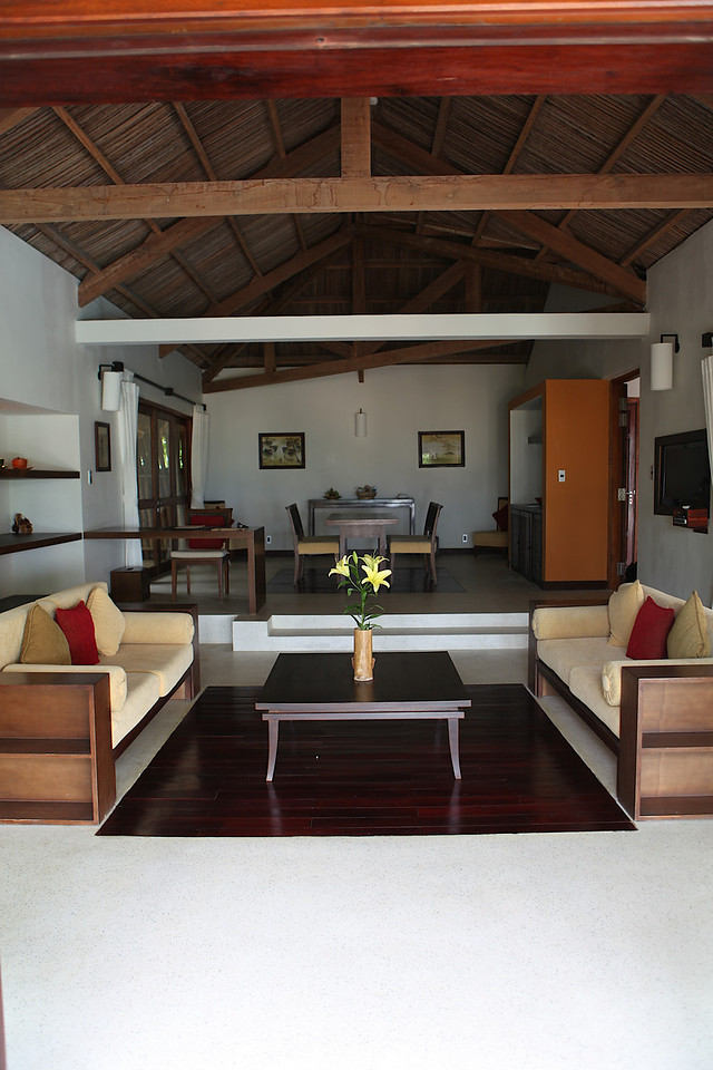 On the other side of the villa is the large dining room and wet bar to the back, with the living room with TV area to the beach side.