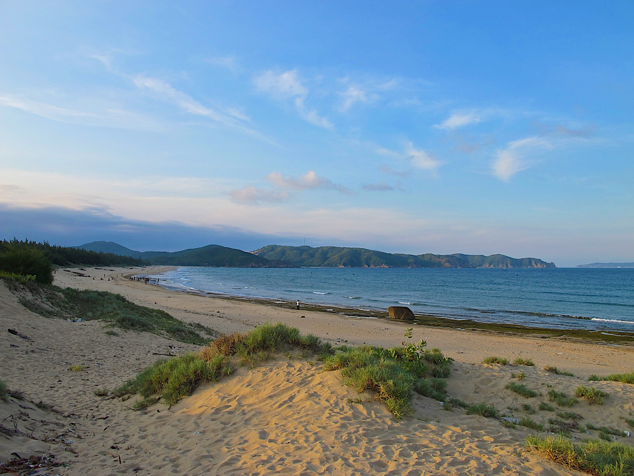 "This is a view from a beach just outside of one of the villages.  Bai Tram is located in the middle of the photo, between the ""2nd and 3rd"" mountain.  You can just see a hint of the beach near the waterline."