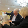 Tim Gould, Dabney Townsend, and Susan Feagin examine Dabney's gift, an antique map of Savannah<br /> Photo: ED