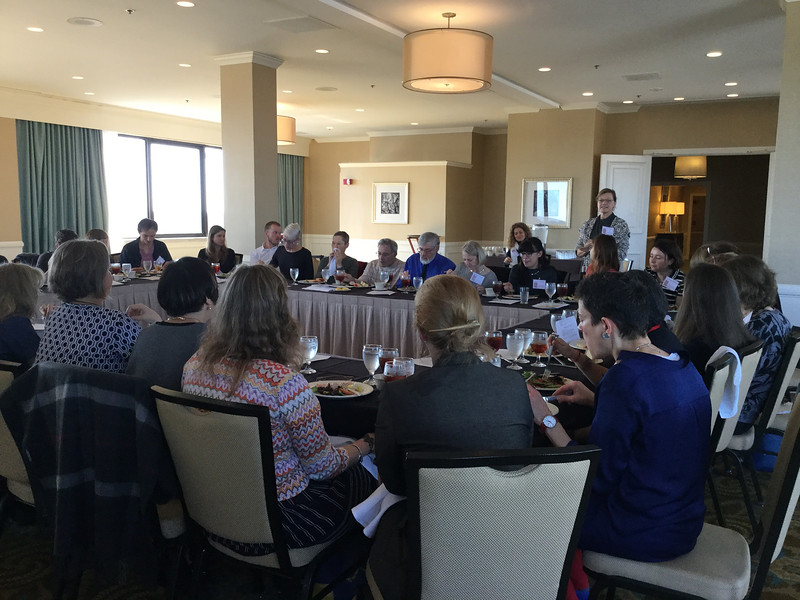 Peg Brand addresses the meeting of the Feminist Caucus over lunch<br /> Photo: CF