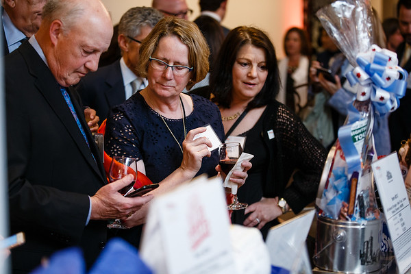 Guests participating in the silent auction during Conquer Cancer Foundation Dinner