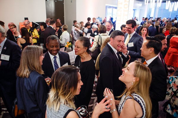 Guests mingling at the cocktail reception during Conquer Cancer Foundation Dinner