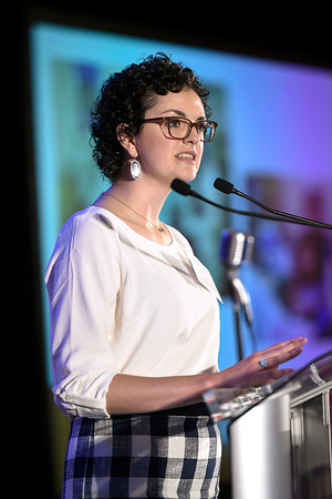 Featured speaker Brittany Sullivan speaks during Conquer Cancer Foundation Dinner