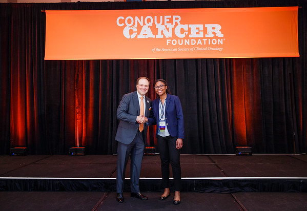 2017 Young Investigator Award Recipient Ibiayi Dagogo-Jack, MD with Thomas G. Roberts, Jr., MD, Chair of the Conquer Cancer Foundation Board of Directors, during 2017 Grants & Awards Ceremony and Reception