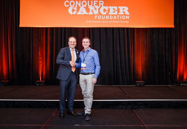 2017 Young Investigator Award Recipient Sebastian Heritier, MD, PhD with Thomas G. Roberts, Jr., MD, Chair of the Conquer Cancer Foundation Board of Directors, during 2017 Grants & Awards Ceremony and Reception