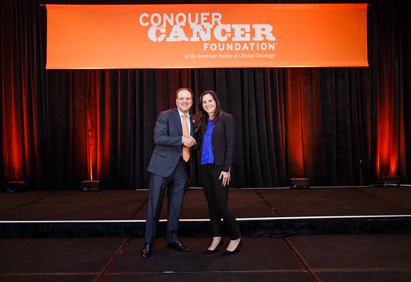 2017 Young Investigator Award Recipient Angela Lamarca  MD, PhD with Thomas G. Roberts, Jr., MD, Chair of the Conquer Cancer Foundation Board of Directors, during 2017 Grants & Awards Ceremony and Reception