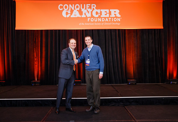 2017 Young Investigator Award Recipient Matthew Hemming, MD, PhD with Thomas G. Roberts, Jr., MD, Chair of the Conquer Cancer Foundation Board of Directors, during 2017 Grants & Awards Ceremony and Reception