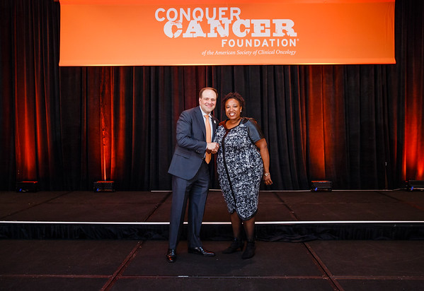2016 Medical Student Rotation Recipient Charelle Smith with Thomas G. Roberts, Jr., MD, Chair of the Conquer Cancer Foundation Board of Directors, during 2017 Grants & Awards Ceremony and Reception