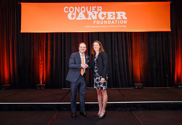 2017 Young Investigator Award Recipient Meredith McKean, MD, MPH with Thomas G. Roberts, Jr., MD, Chair of the Conquer Cancer Foundation Board of Directors, during 2017 Grants & Awards Ceremony and Reception